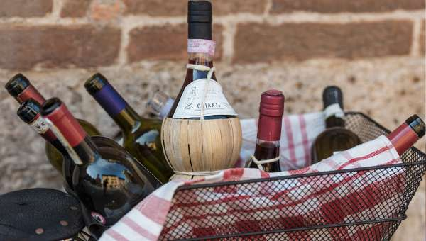 Bottles of wine in a basket from the Chianti Region of Italy