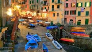 Colorful boats and buildings adorn the Port of Cinque Terre at night