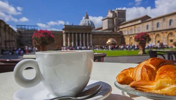 Coffee cup & cornetto in the Vatican Museum Courtyard in Rome