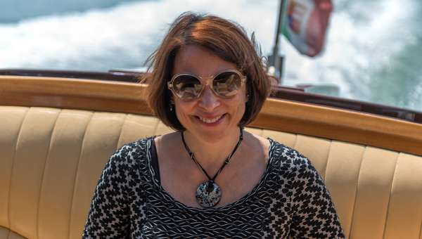Carmen, Your Own Italy's founder & President riding on a boat in Venice