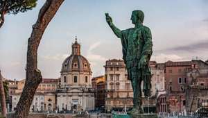 View of statue of Caesar Augustus with the ancient Roman Forum in the background
