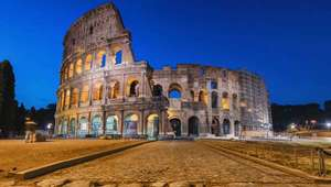 Rome's Colosseum illuminated against the evening sky, Italy tours